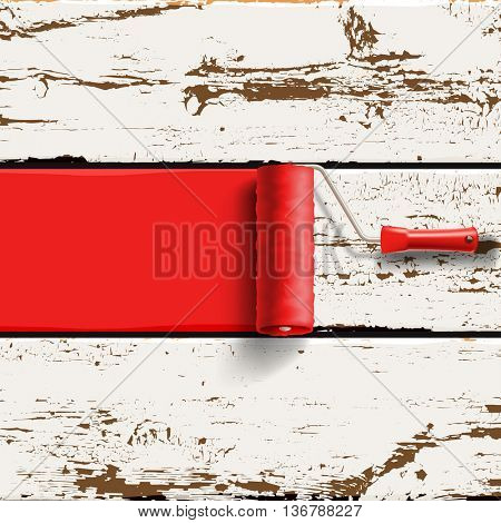roller brush with red paint on the old painted wood panels background
