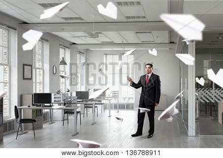 Businessman with mobile phone in hand . Mixed media