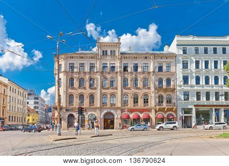 RIGA LATVIA - JUNE 29 2016: Old residential house (circa 19th c.) on the Aspazijas (former Theater) Boulevard in the historic center of Riga Latvia. World Heritage Site of UNESCO