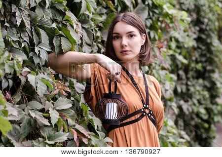 Beautiful dark haired girl in a boho dress, street fashion