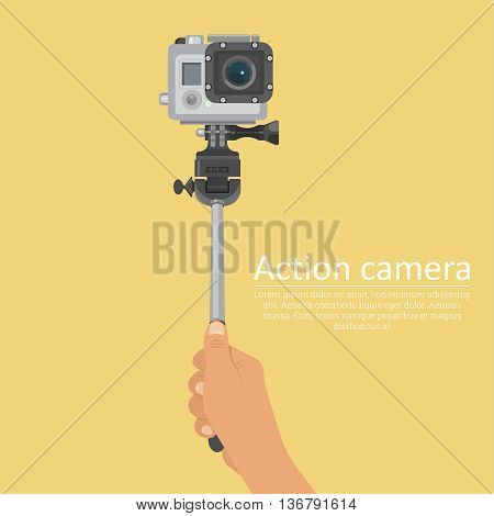 Hand holding a stick for a selfie with action camera for a photo and video filming. A vectorial illustration in plane style.