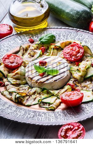 Grill Brie camembert cheese zucchini with chili pepper and olive oil. Italian mediterranean or greek cuisine. Vegan vegetarian food.