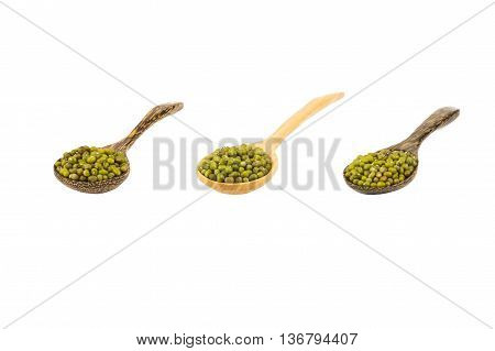 Mung beans in wood spoon isolated on white background