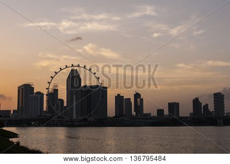 Waterfront sunset view of Singapore Skyline a modern urban city