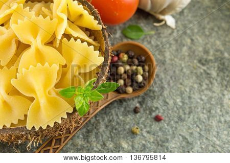 Uncooked Pasta In A Bowl With Vegetables