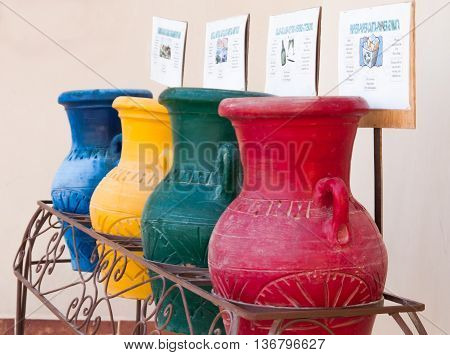Colorful clay pots in a trash can at the hotel in Hurghada Egypt