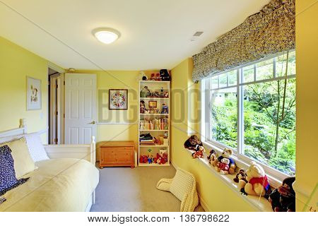 Kids Play Game Room With Yellow Walls And Lots Of Toys.