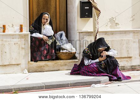 SELARGIUS, ITALY - 2015 September, 13: Former marriage Selargino - Sardinia - girls in Sardinian costumes are resting at the end of the parade