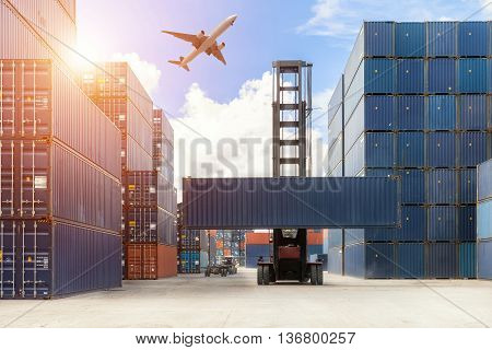 Crane lifter handling container box loading to truck use for export import logistics background.