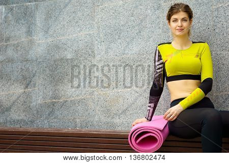 Caucasian athletic woman in sports suit resting after fitness