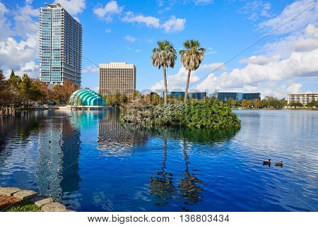 Orlando skyline from lake Eola in Florida USA with palm trees