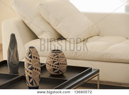 Ornate Vases On A Table Next To Sofa