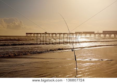 Daytona Beach in Florida shore with pier and fishing rod USA