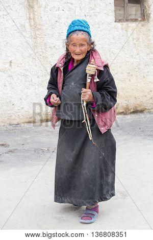 LAMAYURU INDIA - JUNE 15 2015: Unidentified buddhist old women during mystical mask dancing Tsam mystery dance in time of Yuru Kabgyat Buddhist festival at Lamayuru Gompa Ladakh North India