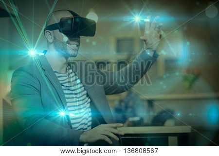 Futuristic black background against male graphic designer wearing virtual glasses