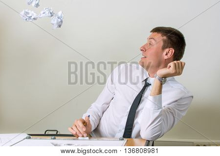Papers Flying Into Young Businessman Face