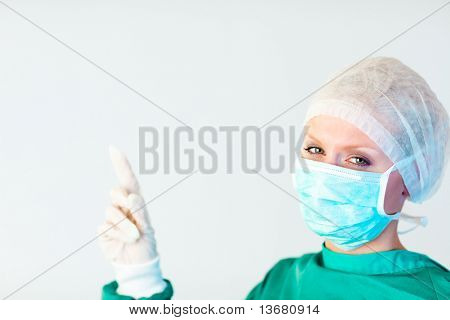 Young female surgeon looking upwards
