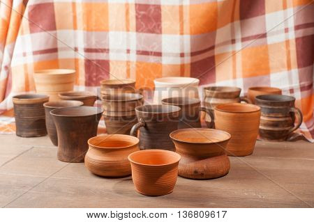 Set of traditional handcrafted mugs on the wooden table