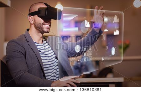Abstract technology interface against male graphic designer wearing virtual glasses