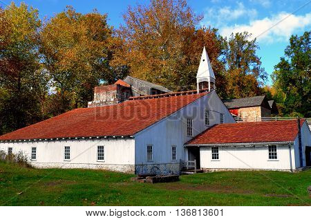 Hopewell Furnace Pennsylvania - October 15 2015: The Cast Iron Shed with its distinctive wooden cupola at Hopewell Furnace National Historic Site *