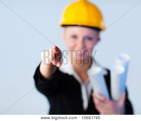 Confident looking forewoman with focus on the object