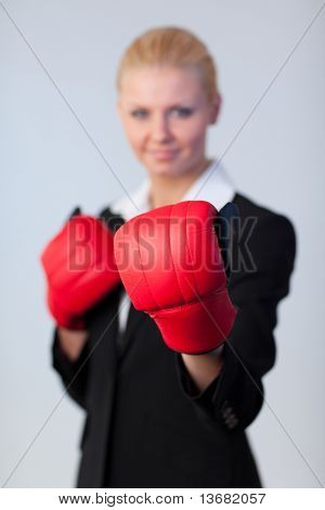 Happy Business woman with Boxing Gloves with focus on Gloves