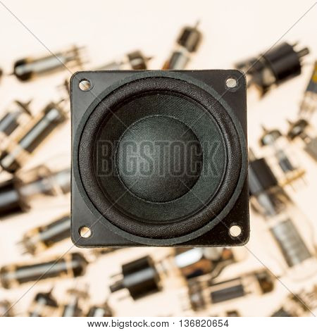 Vacuum electronic tubes and uncabled loudspeaker on white background