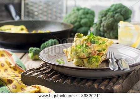 Finnis omelet with broccoli farel potatoes and onions. Rustic style. Selective focus.