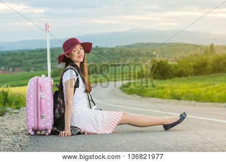Lonely Girl Sitting On The Road