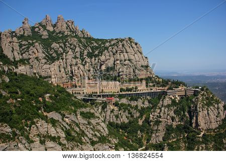 Montserrat Mountain , a huge bald rock forming the mountain, the climb is, as idols. Narrow channels resemble the intricate patterns, the monkey, the elephant, the mummy, visible brown house
