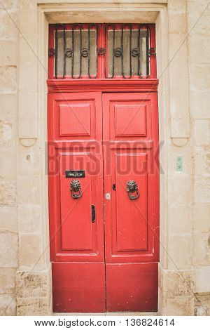 Red Wooden Doors with Black Lion Shaped Metal Knockers in Mdina Malta