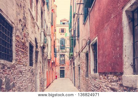 Background with old medieval houses along narrow street of Venice Italy