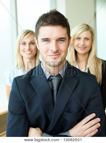 Portrait of three young business people with folded arms