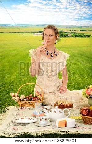 portrait if vintage woman at picnic with roses