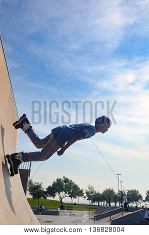 Istanbul Turkey - June 4 2016: Avcilar Skatepark. In the area of 2000 square meters skatepark young skaters under the blue sky seems almost like flying.