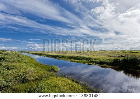 Connor Creek under a dramatic blue sky in Copalis Washington.