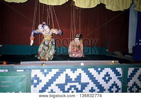PAGAN, MYANMAR / CIRCA 1987: Puppets controlled by strings entertain people at a puppet show in Pagan.