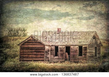 old abandoned farmhouse on a prairie, St Vrain State Park near Longmont, Colorado,, grunge and gritty texture picture finish
