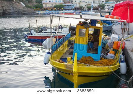 Fishing boat in the small port located in Fish Village Bali on Crete island in Greece.