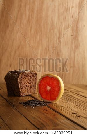 Exotic lavender grapefruit bread alternatively baked in artisan bakery presented on wooden table and rustic background