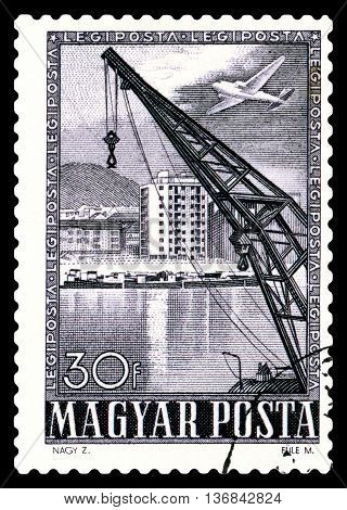 STAVROPOL RUSSIA - JUNE 28 2016: a stamp printed by Hungary shows Crane and apartment house circa 1950