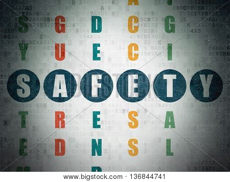 Safety concept: Painted blue word Safety in solving Crossword Puzzle on Digital Data Paper background