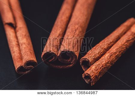 cinnamon sticks. Top view of cinnamon sticks isolated on white