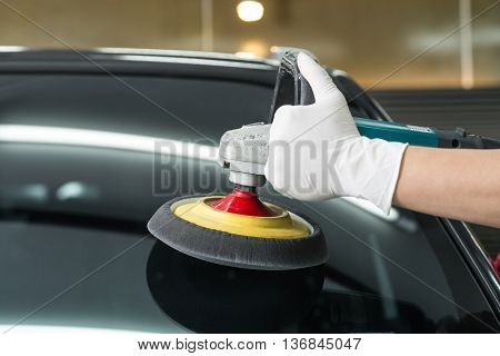 Car detailing series : Closeup of hand buffing windshield