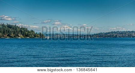 A view of majestic Mount Rainier across Lake Washington. Photo taken at Seward Park in Seattle.