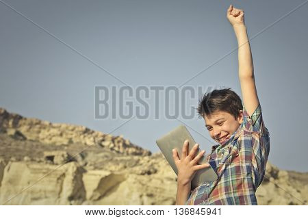 Successful boy feeling joyful