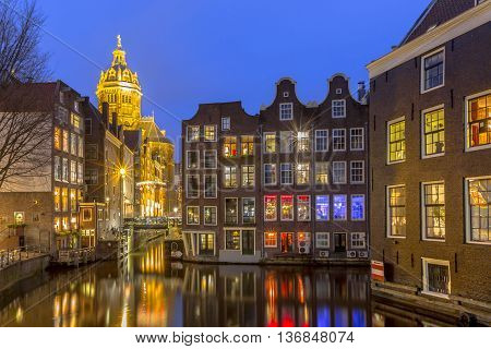 Waterfront Canal Houses At Twilight Amsterdam