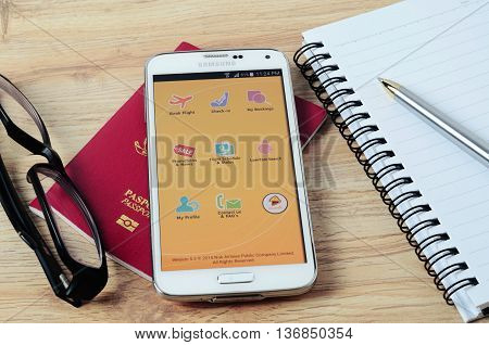 KOTA KINABALU MALAYSIA - JULY 1 2016: Nok Airlines on mobile app the app helps managing travel plans make bookings check-in and choose seat anytime anywhere.