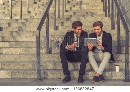 Handsome Young Businessmen With Gadget