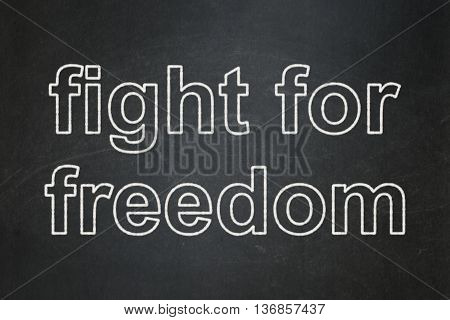 Political concept: text Fight For Freedom on Black chalkboard background